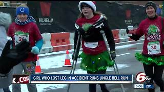 Girl who lost leg in train accident runs Jingle Bell Run - Video