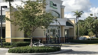 Bank robbery investigated in suburban West Palm Beach - Video