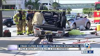 Crash closes busy intersection in West Palm Beach - Video