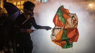 Hong Kong police dispense tear gas, fire rubber bullets at thousands of protesters