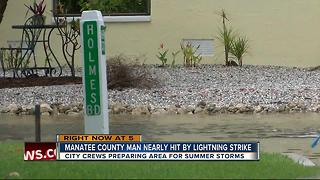 Man reports nearly getting struck by lightning on Holmes Beach - Video
