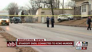 Police involved in 4-hour standoff connected to homicide - Video