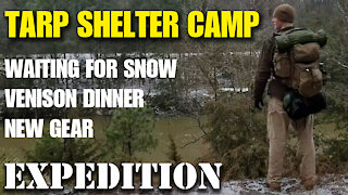 Heated tarp shelter overnight camp in freezing weather