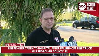 Firefighter flown to hospital as trauma alert after falling off fire truck in Hillsborough County - Video