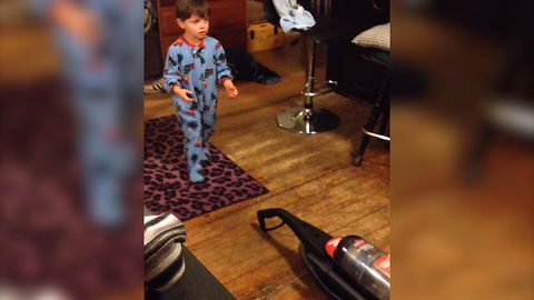 Cute Kid Has Fear Of Vacuum