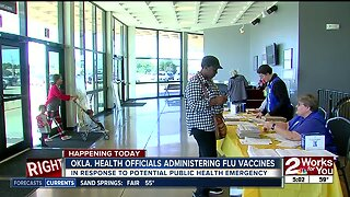 Health officials administering flu vaccine