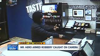 Mr. Hero armed robbery caught on camera - Video