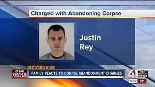 Man charged with abandoning wife's body