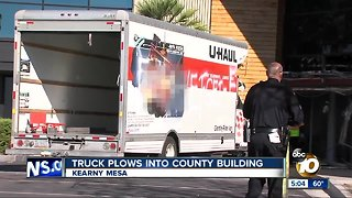 Truck plows into San Diego County building