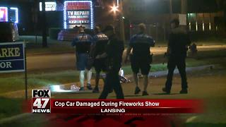 Lansing Police patrol car damaged at fireworks show - Video