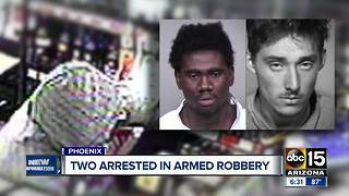 Two men arrested in armed robbery, one was wearing a Joker style mask - Video