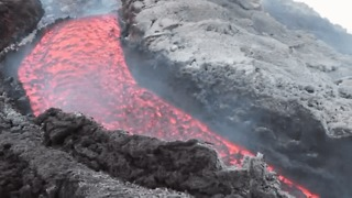 Glowing River of Lava Emerges From Mount Etna - Video