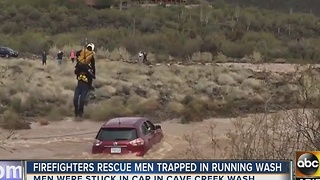 Men rescued from running wash in Cave Creek - Video