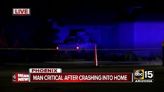 Man seriously hurt after crashing into Phoenix home