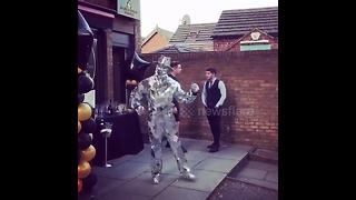 Human disco ball shimmers as he dances - Video