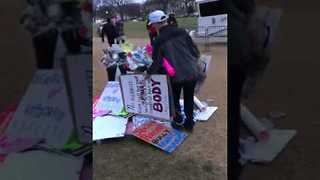 Man in 'Make America Great Again' Hat Seen Cleaning Up After Women's March - Video