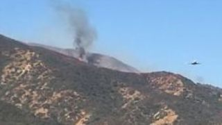 Plane Drops Fire Retardant on Canyon Fire Near Corona - Video