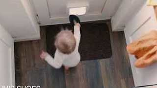 Toddler Disposes Toys Through Cat Flap - Video