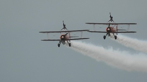 Awesome wingwalkers perform insane stunts during airshow
