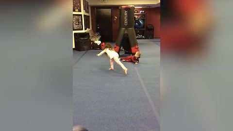 Toddler Boy Fails In Doing A Cartwheel And Falls Flat On His Stomach