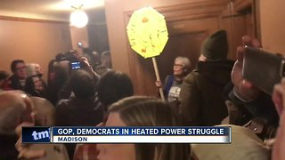Protesters fight GOP's power-stripping plan during lame-duck session