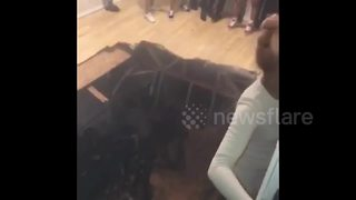 Terrifying moment floor collapses at Texas house party - Video