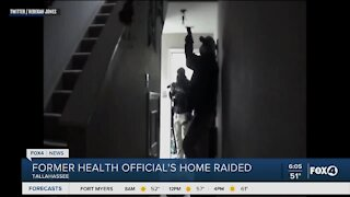 Former health official's home raided