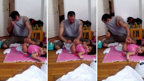 Watch dad's hilarious reaction as he attempts to change his daughter's explosive nappy