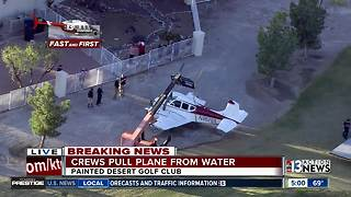 Plane pulled out of water at golf course - Video