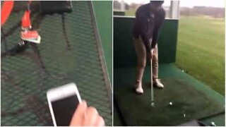 Boy accidentally hits his iPhone with a golf club!