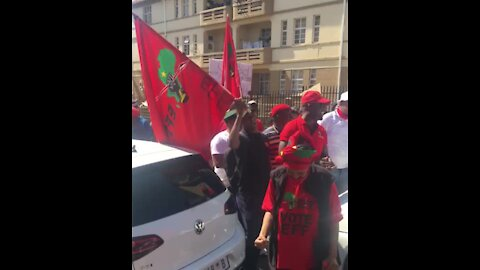 EFF members outside Hillbrow police station