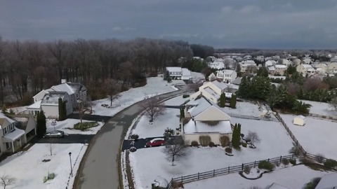Neighborhood Covered in Snow During Storm