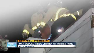 Man wedged inside chimney of former home - Video