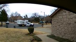 Surveillance video: Trash truck passes by full bins - Video