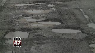 Snow halting pothole repair - Video