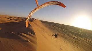 O-man! Daredevil flies across Oman desert with paramotor