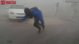 Meteorologist Gathering Data During Hurricane - Video