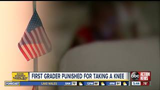 First grader told to stand after taking a knee during Pledge of Allegiance - Video