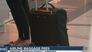 United to charge fee for overhead bin - Video