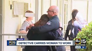 Mesa police officer carries distressed woman to work - Video