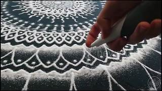 Artist creates mesmerising mandala using salt - Video