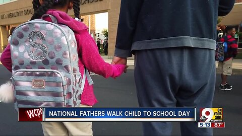 Elementary school highlights the importance of dads with a morning walk to school