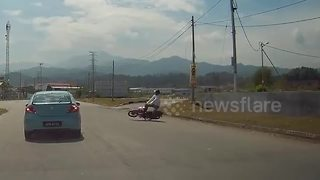 Downed power lines cause motorcycle rider to fall - Video