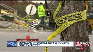 SUV slams into coffee shop