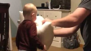 Baby loves a good pillow fight!