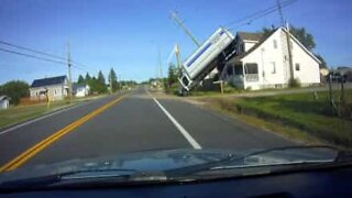 Truck cartwheels onto roof of house during bizarre accident