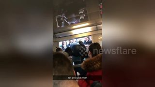 Desperate commuters board train through windows during French rail strike - Video