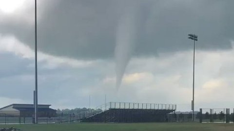 Funnel Clouds Loom Over High School in Iowa