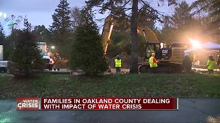 Families in Oakland County dealing with impact of water crisis - Video