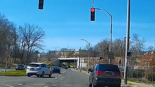 Dash cam captures back-to-back red light runners - Video